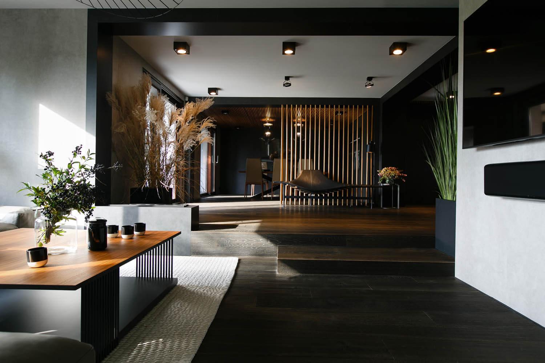 prestiżowy apartament utrzymany w ciemnej kolorystyce w Krakowie.Ekskluzywne wnętrze projektowane przez architektów.